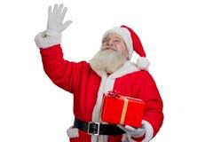 Santa Claus ondulant avec la main, portrait Images stock