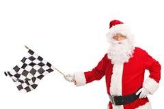Santa Claus ondulant un drapeau à carreaux de course Photo libre de droits