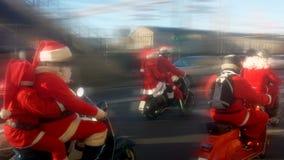 Santa Claus op een autoped Royalty-vrije Stock Afbeeldingen