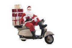 Santa Claus op uitstekende autoped Stock Afbeelding