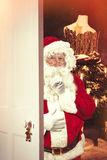 Santa Claus At Open Christmas Door Royaltyfri Fotografi