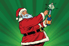 Santa Claus opens a bottle of champagne. Pop art retro vector. Christmas holiday and New year. Alcohol and sparkling wine Royalty Free Stock Photography