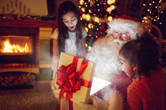 Santa Claus opens a box with Christmas magic Royalty Free Stock Photos