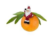 Santa Claus on orange mandarin Stock Photo