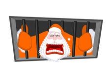 Santa Claus orange prisoner clothing. Christmas in prison. Windo Stock Images