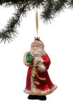 Santa Claus Ornament. Hanging from a pine bough set against a white background Stock Photos
