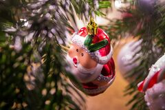 Santa Claus ornament hanging on Christmas Tree Stock Photography