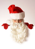 Santa claus over blank board Royalty Free Stock Photography
