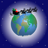 Santa claus over the world. Santa claus in his sleigh travelling by the globe Stock Images