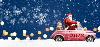 Santa Claus på bilen Arkivfoto