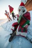 Santa Claus på en cykel med ett dragspel Royaltyfria Foton