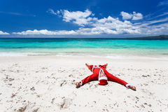 Santa Claus på stranden Arkivfoto