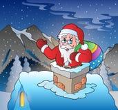 Santa Claus på taket i berg Arkivbild