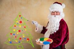 Santa Claus painter Stock Image