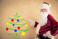 Santa Claus painter Royalty Free Stock Photo