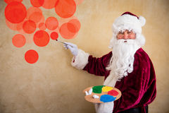 Santa Claus painter Stock Photos