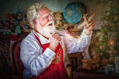 Santa Claus Painting Toys Stockfotos