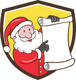 Santa Claus Paper Scroll Pointing Shield-Karikatur Lizenzfreies Stockbild