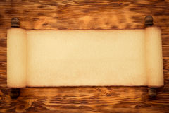 Santa Claus paper scroll on wood Stock Photo