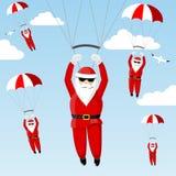 Santa Claus on a parachute. Royalty Free Stock Photography