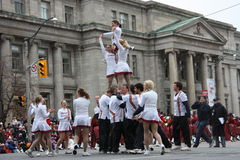 The Santa Claus Parade 2008. A cheerleader's pyramid made by members of Queen's University Cheerleaders Team, with the top girl doing splits, during the Santa Royalty Free Stock Photo