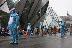 The Santa Claus Parade 2008. Participants in the Santa Claus parade wearing blue bunny costumes with carrots.  Held November 16, 2008, Toronto, Ontario, Canada Royalty Free Stock Images