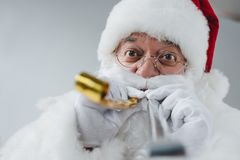 Santa claus with party blowers royalty free stock images