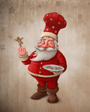 Santa Claus pastry cook. With gingerbread man cookies Stock Photos
