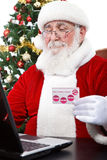 Santa Claus paying with credit card Stock Photo