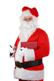 Santa Claus with pen and notebook Royalty Free Stock Image