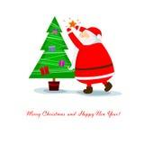 Santa Claus pendura a estrela Imagem de Stock