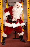 Santa Claus physical  training before Christmas in gym - kettlebells Stock Photography