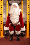 Santa Claus physical  training before Christmas in gym - kettlebells Stock Photos
