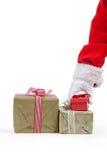 Santa claus picking a christmas gift Royalty Free Stock Image