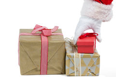 Santa claus picking a christmas gift Royalty Free Stock Photos