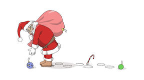 Santa Claus picking up a toy royalty free stock photo