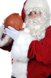 Santa Claus with a pig money box Stock Photography