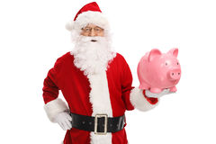 Santa claus with a piggybank. Isolated on white background Royalty Free Stock Image