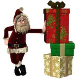 Santa Claus with pile of Christmas Gifts Royalty Free Stock Photo