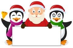 Santa Claus & pingvin med det tomma banret Arkivfoton