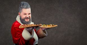 Santa Claus with pizza in hands . stock images