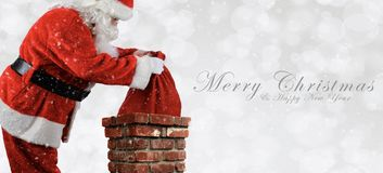 Santa Claus Placing Bag in Chimney - Banner size royalty free stock photography