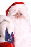 Santa Claus and plastic credit cart. Royalty Free Stock Photos