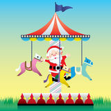Santa Claus play the merry go round Royalty Free Stock Photos