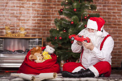 Santa Claus played with toys Stock Images