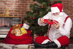 Santa Claus played with toys Stock Photography