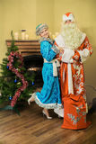Santa Claus and playful snow maiden Stock Image