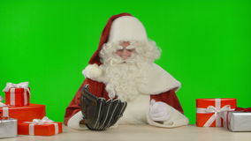 Santa Claus is Playing with a Baseball and a Catcher's Glove stock footage