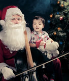 Santa Claus playing cello over dark background Stock Images
