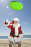 Santa Claus Playing With Flying Disc stock foto's